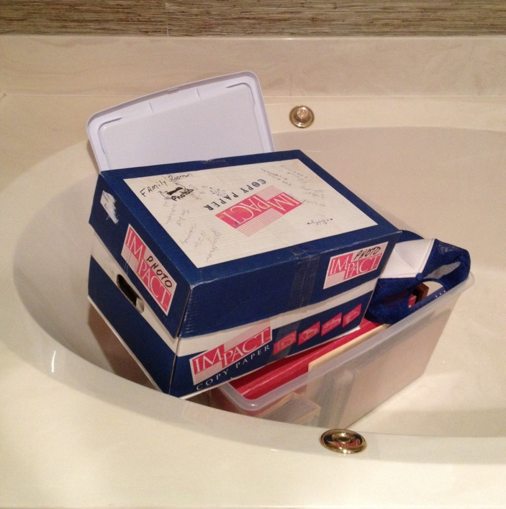 2 of 3 boxes of Papa's stuff in the bathtub