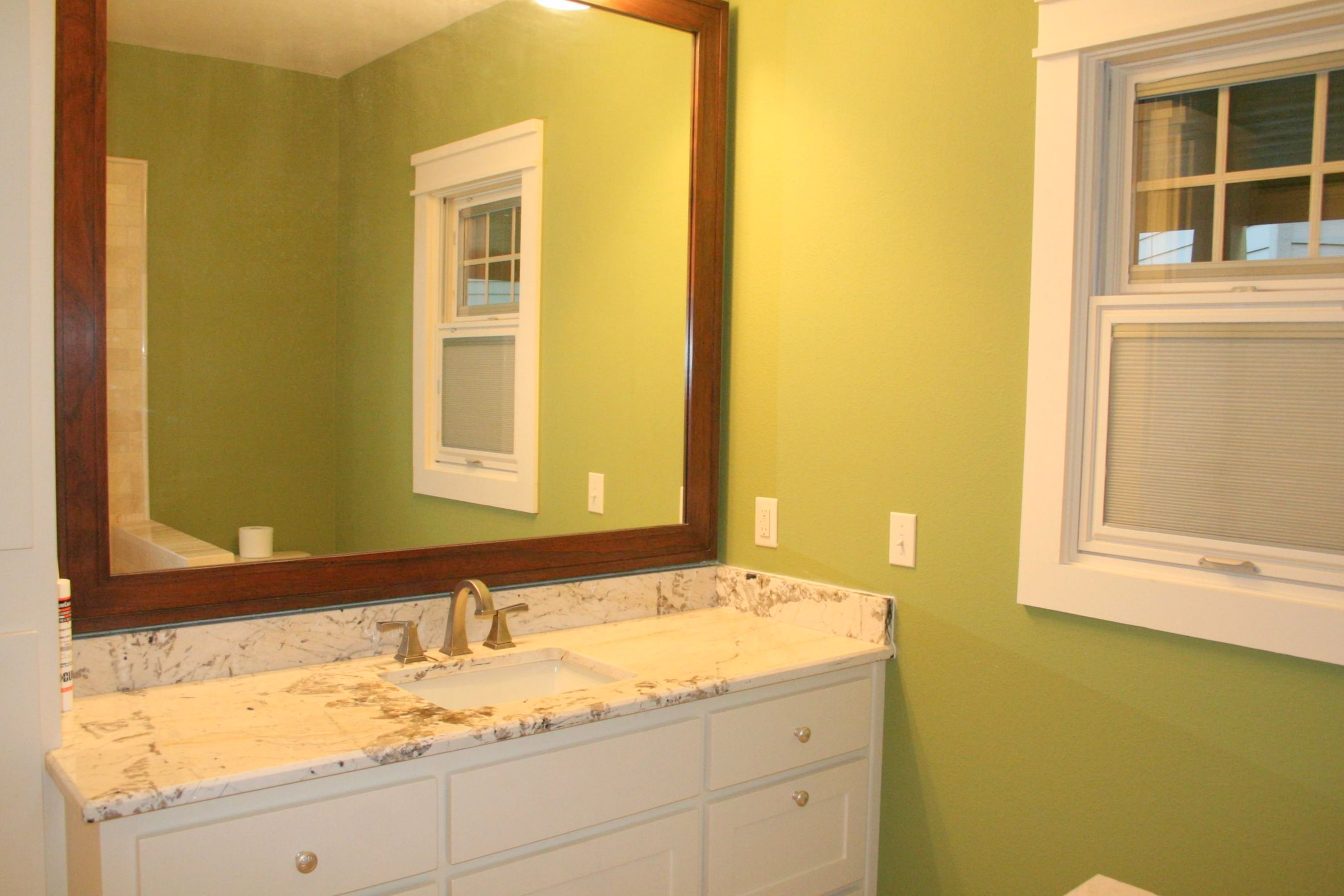 After bathroom with mirror that has been in all 5 houses