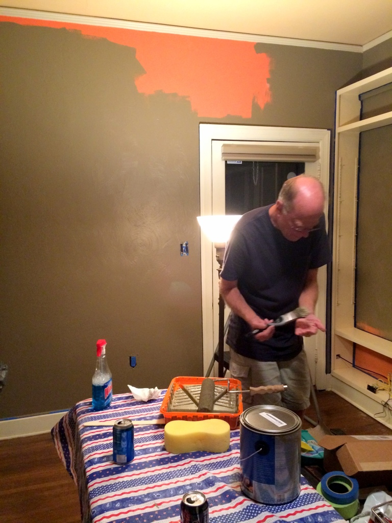 Randy painting James' room.  Check out the beer cans.