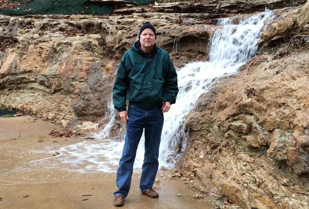 Randy braving the waterfall in 32 degree weather