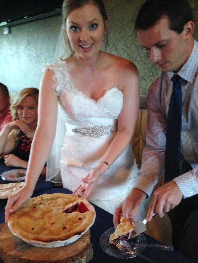 "Brandi and Matt cutting the ""cake"""